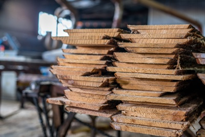 Woodworking Plant. Boards Stacked In Pile